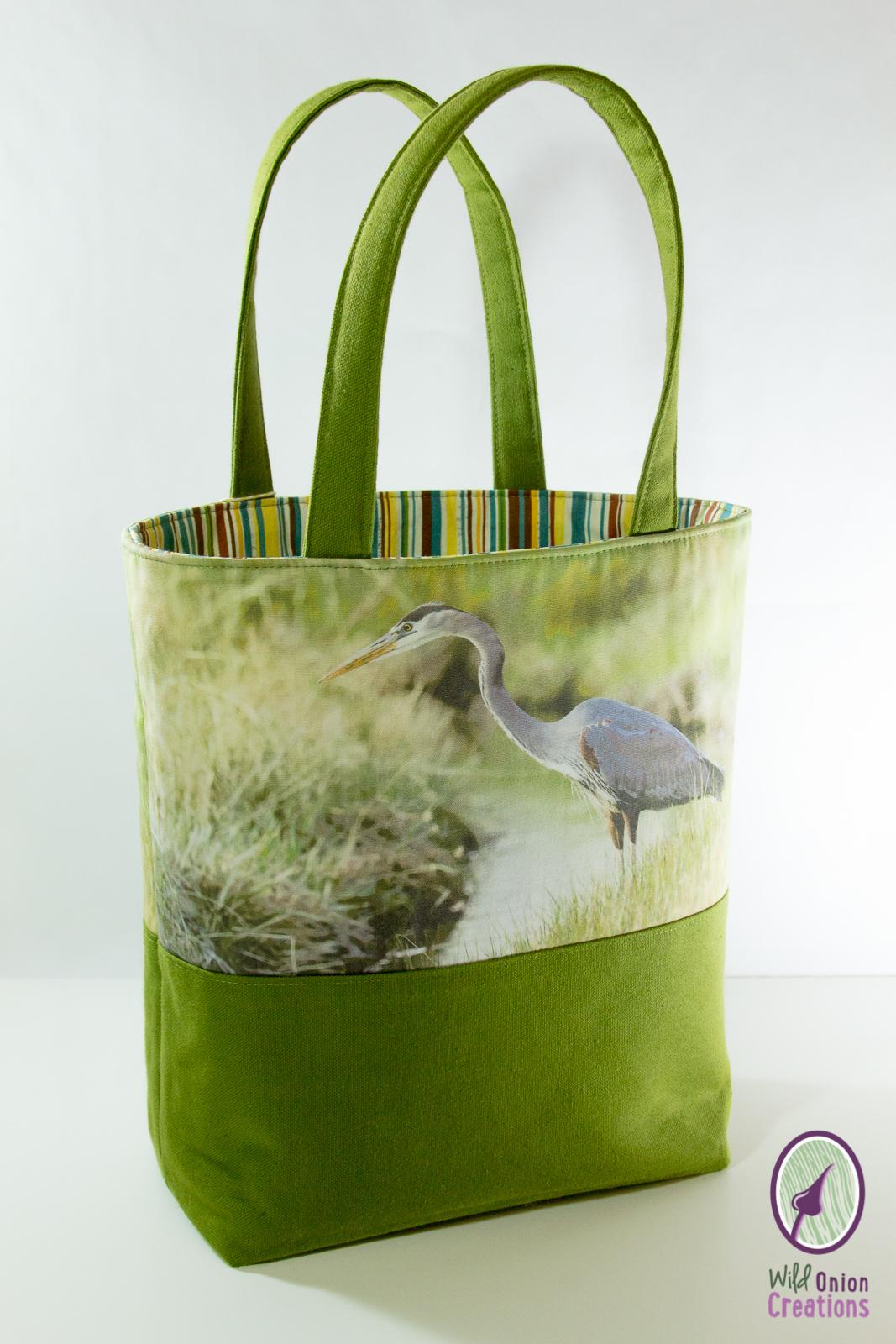great blue heron book tote bag
