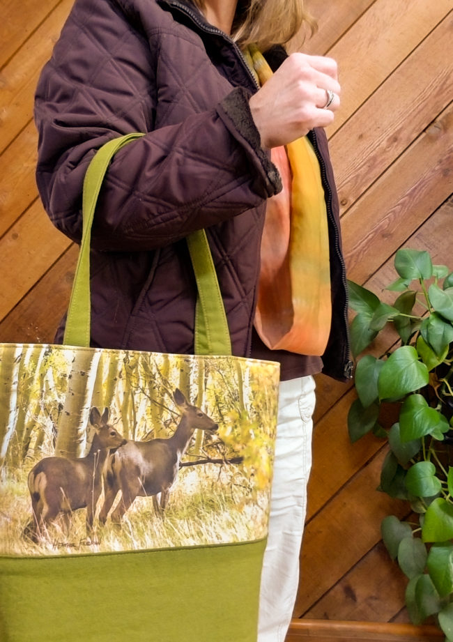 Ready for a day on the town, take this glowing fall colors and foraging deer tote bag with you to keep all your things organized