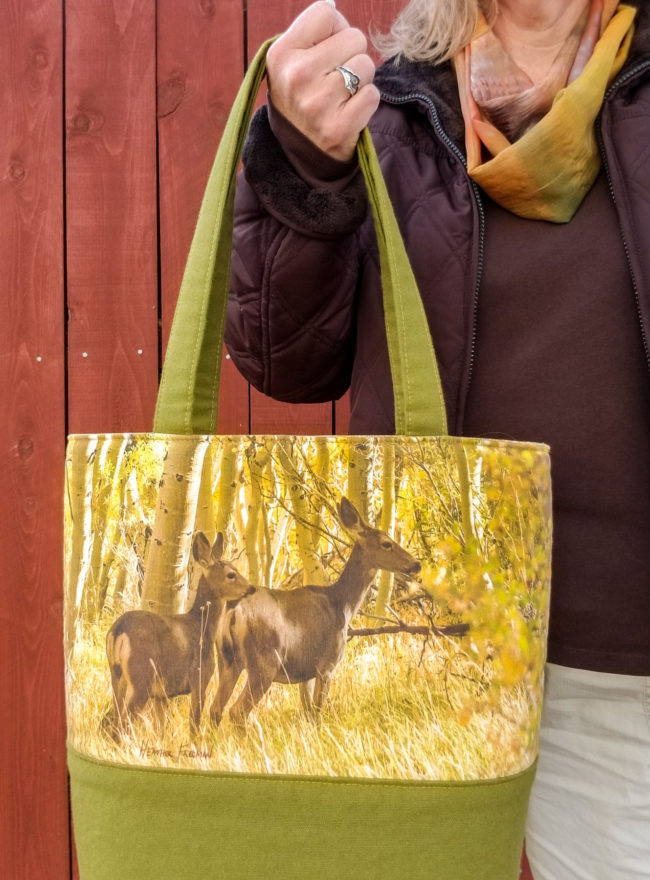 Pack up a nice picnic in this scene of foraging deer among the golden aspen trees year-round with this handmade tote bag by Wild Onion Creations